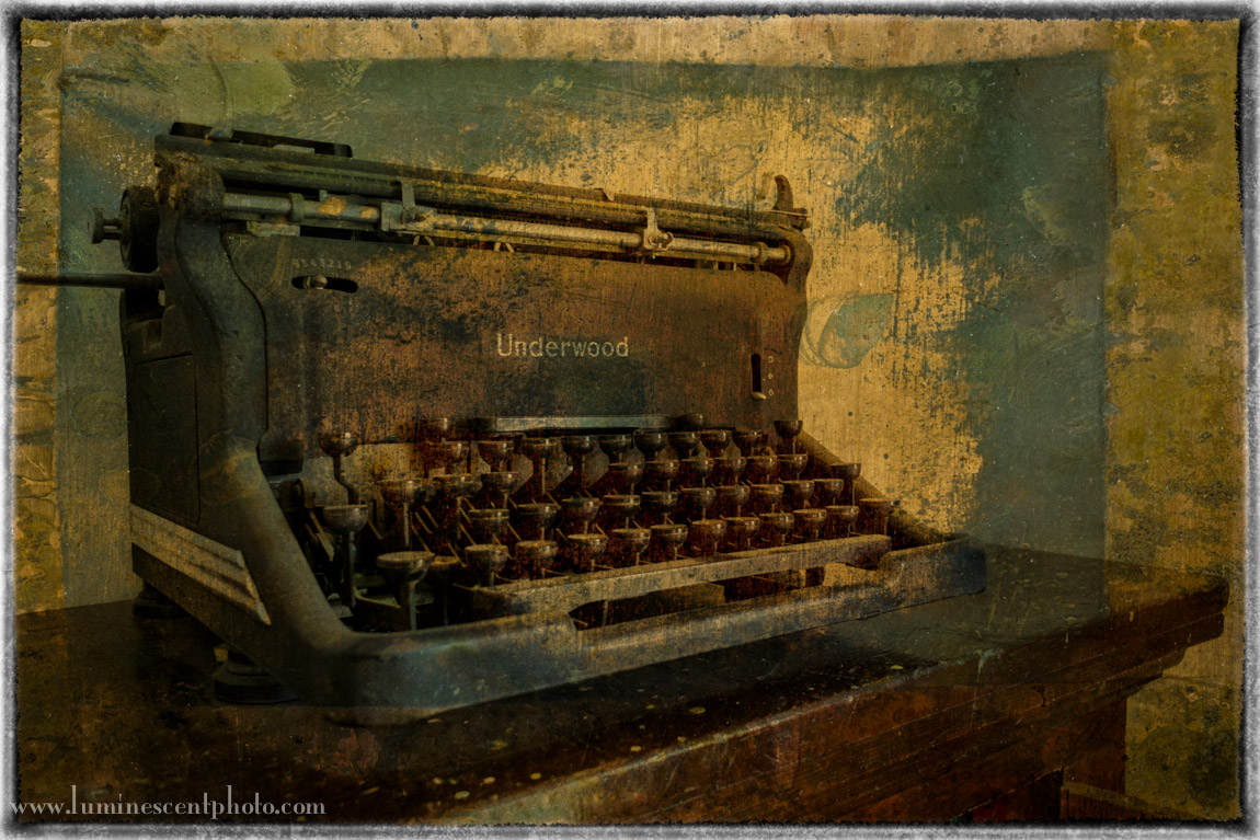 Antique typewriter, Florissant, CO. Nikon 1 V2 with 10mm f/2.8 1-Nikkor lens, Flypaper texture.