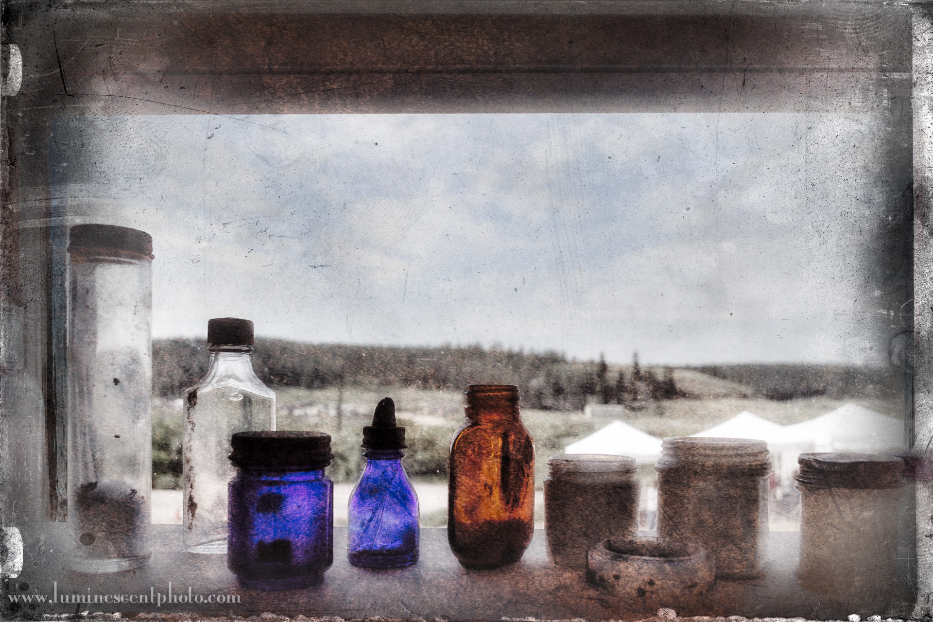 Bottles and jars, Florissant, CO. Nikon 1 V2 image processed in Color Efex Pro 4 with Flypaper texture overlays.