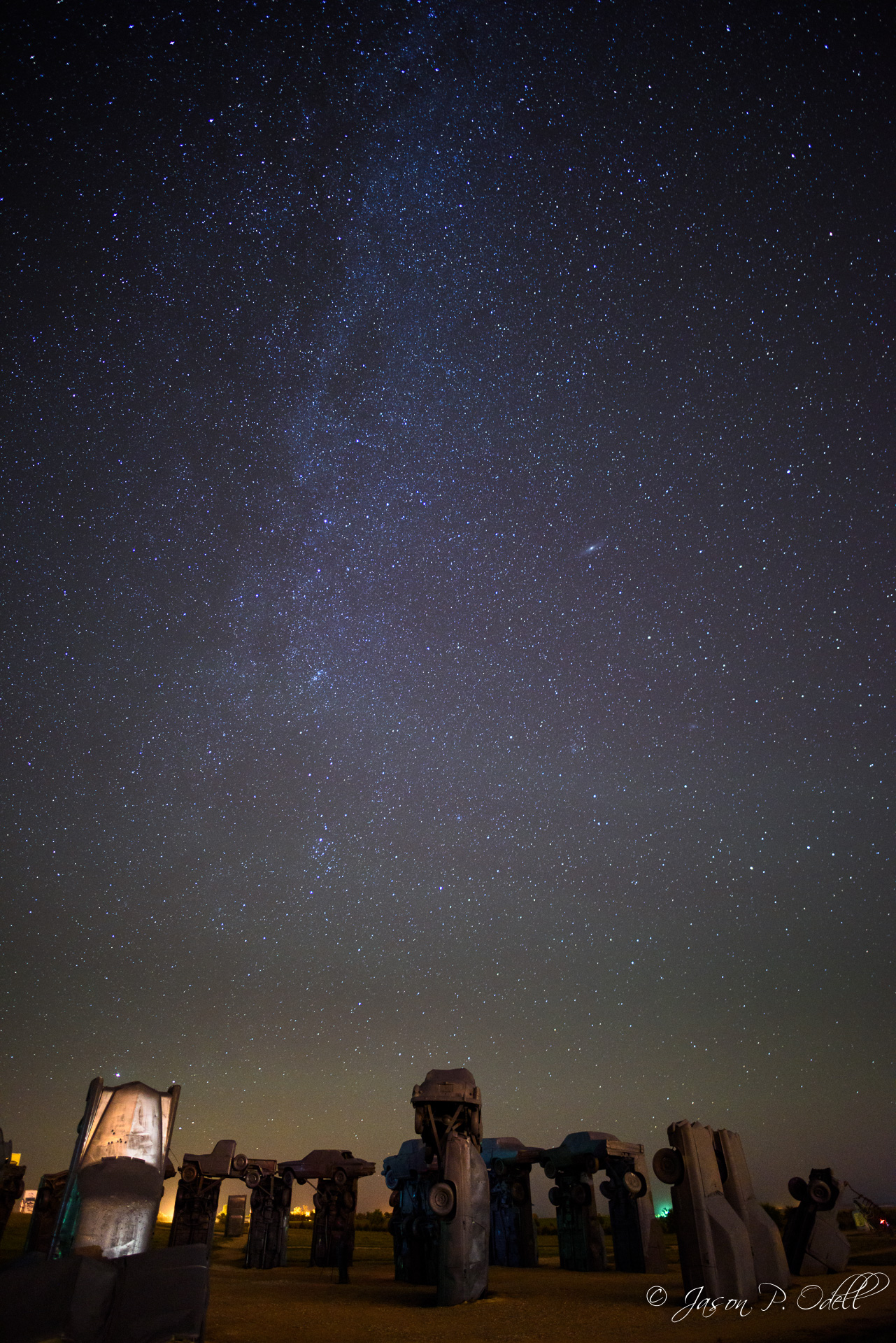 The Milky Way stretches over Carhenge in Alliance, Nebraska. You can see the Andromeda galaxy at center right (click to enlarge).