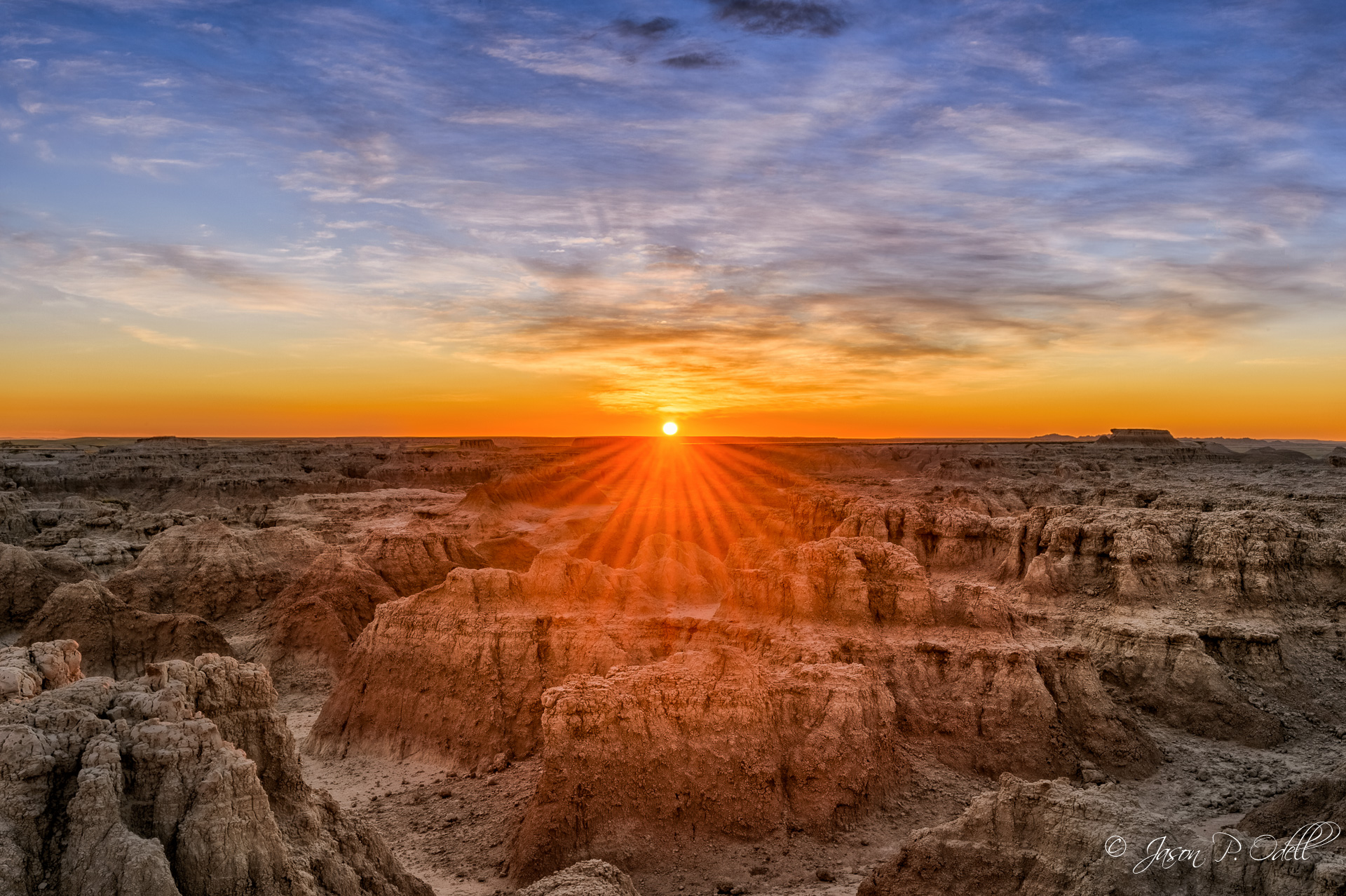 """The moment it hits you"" Sunrise over Badlands National Park, South Dakota."