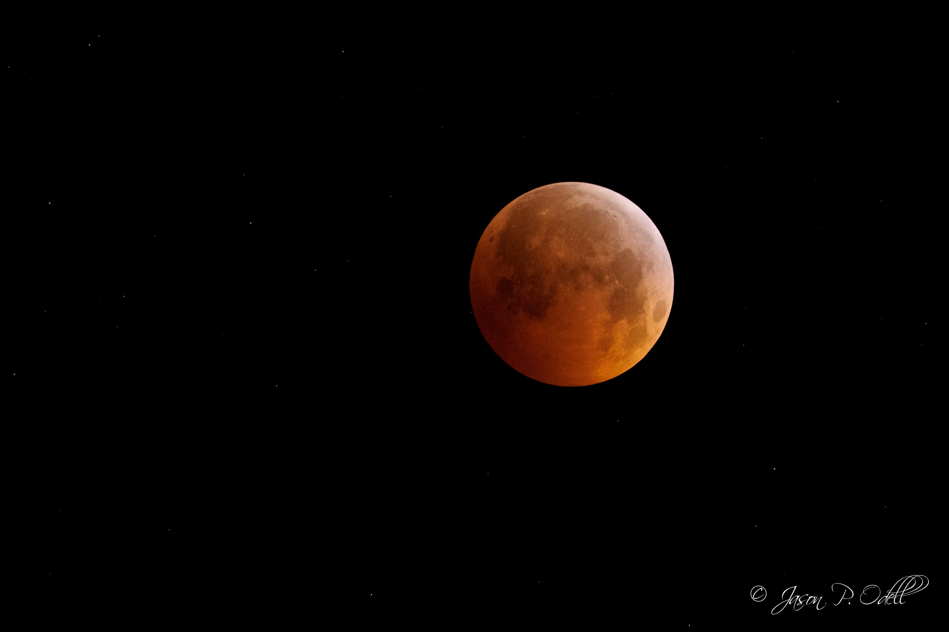 During a total lunar eclipse, the moon gets really dim. To capture this shot, I had to boost the ISO to 8000 just to get a 1/8 sec exposure!